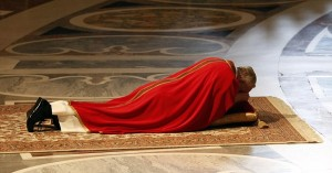 Pope Francis lies as he prays during the Celebration of the Lord's Passion in Saint Peter's Basilica at the Vatican